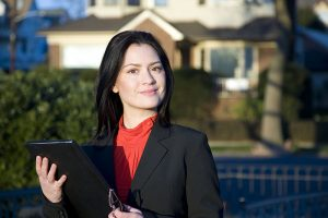 Business woman with real estate appraisal documents